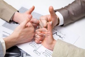 4921473-image-of-human-hands-with-their-thumbs-up-symbolizing-success-in-work
