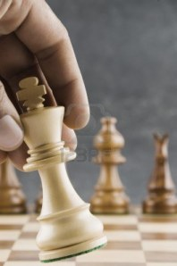 10220747-human-hand-moving-a-king-chess-piece